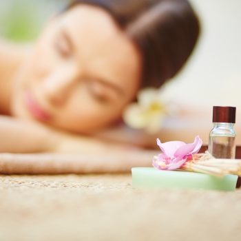 Products for beauty care with relaxed female on background